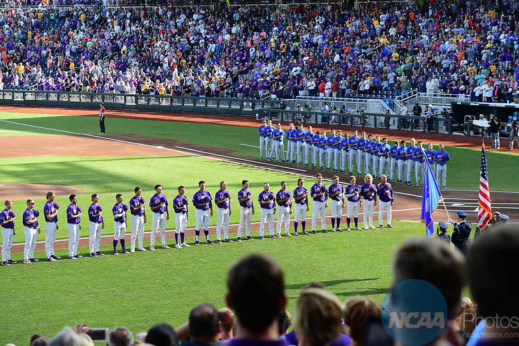 OMAHA, NE - JUNE 26: Players line up for the national anthem as Louisiana State University takes on the University of Florida during the Division I Men's Baseball Championship held at TD Ameritrade Park on June 26, 2017 in Omaha, Nebraska. The University of Florida defeated Louisiana State University 4-3 in game one of the best of three series. (Photo by Justin Tafoya/NCAA Photos via Getty Images)