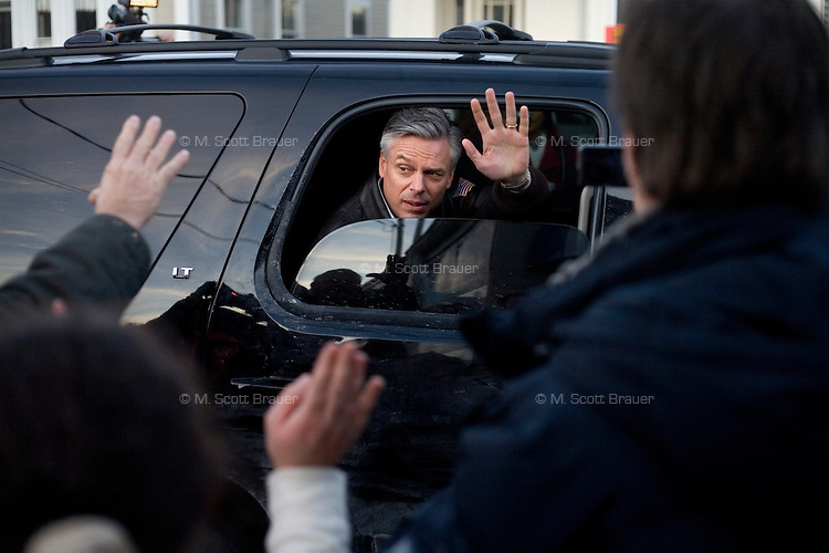 Former Utah governor Jon Huntsman waves to the crowd after leaving a campaign event at Crosby's Bakery in Nashua, New Hampshire, on Jan. 9, 2012.  Hunstman is seeking the 2012 Republican presidential nomination.
