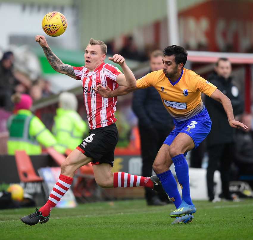 Lincoln City's Harry Anderson vies for possession with Mansfield Town's Malvind Benning<br /> <br /> Photographer Chris Vaughan/CameraSport<br /> <br /> The EFL Sky Bet League Two - Lincoln City v Mansfield Town - Saturday 24th November 2018 - Sincil Bank - Lincoln<br /> <br /> World Copyright © 2018 CameraSport. All rights reserved. 43 Linden Ave. Countesthorpe. Leicester. England. LE8 5PG - Tel: +44 (0) 116 277 4147 - admin@camerasport.com - www.camerasport.com