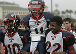 East Manatee Bulldogs John Johnson, Jr. (10) and Jared Williams (22) hoist  Zachary Hammond (11) to celebrate their win over the Hacienda-La Puente Conquerors during the Pop Warner Super Bowl at Disney's Wide World of Sports complex in Orlando, FL, Friday, Dec. 9, 2005.(AP Photo/Brian Myrick)