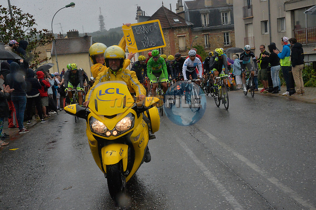 Claire holds up her board for the final stage at the start of Stage 21 of the 2015 Tour de France running 109.5km from Sevres to Paris - Champs Elysees, France. 26th July 2015.<br /> Photo: ASO/B.Bade/Newsfile