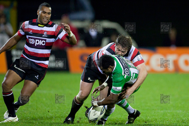 Jono Owen's strong tackle causes Tomasi Cama to drop the ball.  ITM Cup rugby game between Counties Manukau and Manawatu played at Bayer Growers Stadium on Saturday August 21st 2010..Counties Manukau won 35 - 14 after leading 14 - 7 at halftime.