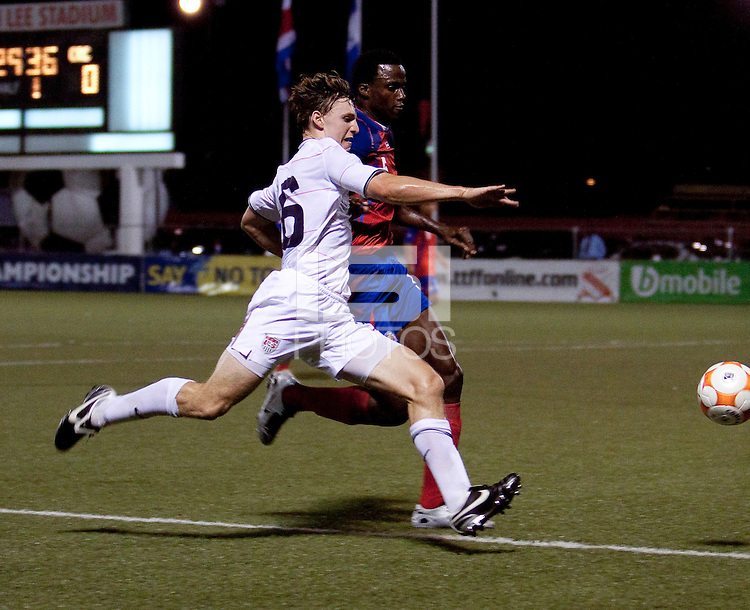 Billy Schuler (16) kicks the ball past Derrick Johnson (5). Costa Rica defeated the US Under 20 Men's National team 3-0 during the 2009 CONCACAF U-20 Championship game at Marvin Lee Stadium Trinidad & Tobago in Macoya, Trinidad on March 17th, 2009.