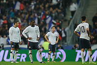 Jermaine Jones, Maurice Edu, Carlos Bocanegra and Clint Dempsey of team USA (l-r) react during the friendly match France against USA at the Stade de France in Paris, France on November 11th, 2011.
