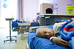 A young cancer patient lies at the new Basrah Children's Hosptial on Saturday, October 23, 2010 in Basrah, Iraq.