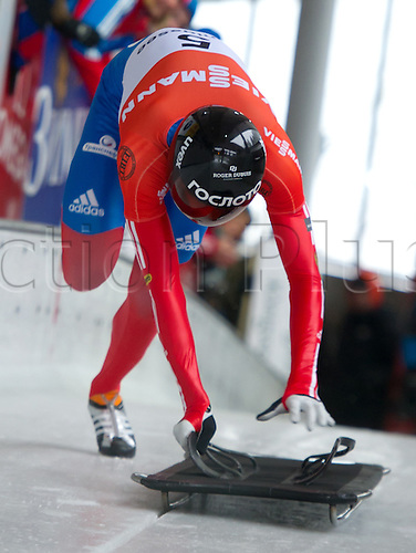 12.01.2013. Koenigsee, Germany.  Russian skeleton pilot Alexander Tretjakow in action during the Skeleton World Cup for men in Koenigssee, Germany, 12 January 2013. Tretjakow wins third place.