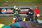 010213--The Oregon Duck raises his arms to the Oregon fans after landing at Salt River Fields during the Ducks pep rally in  Scottsdale, Arizona. .Photo by Jaime Valdez