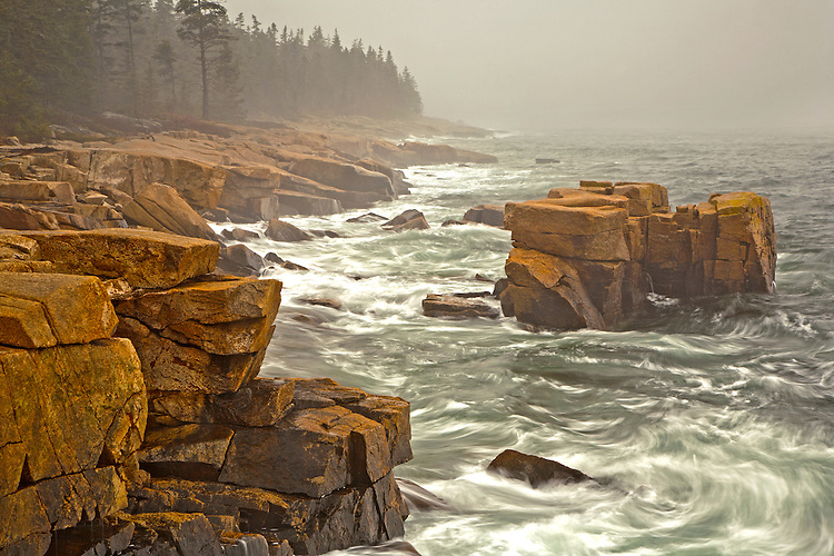 Waves swirl around the granite rocks along the shoreline of Schoodic Peninsula in Acadia National Park, Maine