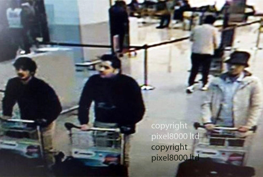 Pic shows: Brussels bombings Suicide bombers pushing trolleys through airport on the way to the target.<br /> <br /> left to right.<br /> <br /> Left -  Man believed to be Najim Laachraoui<br /> <br /> Suspect sought  by Belgian police thought to be bomb- maker Najim Laachraoui<br /> <br /> <br /> Centre: Brussels bombings Belgian bomber man believed to be Ibrahim El Bakraoui pushing trolley through airport with single gloved hand.<br /> <br /> <br /> right:  Brussels bombings &quot;Man in White&quot; believed to be Faycal Cheffou<br /> <br /> <br /> <br /> Pic by Pixel 8000 Ltd