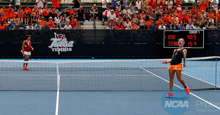 24 MAY 2016: Oklahoma State's Katarina Adamovic celebrates a set-winning point against Sanford's Carol Zhao during singles play. The Division I Women's Tennis Championship is held at the Michael D. Case Tennis Center on the University of Tulsa campus in Tulsa, OK. Stanford defeated Oklahoma State for the National Championship  Shane Bevel/NCAA Photos