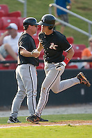 Gordon Beckham (8) of the Kannapolis Intimidators shakes hands with Kannapolis Intimidators manager Nick Capra as he rounds third base following his first professional home run at L.P. Frans Stadium in Hickory, NC, Sunday August 17, 2008. (Photo by Brian Westerholt / Four Seam Images)