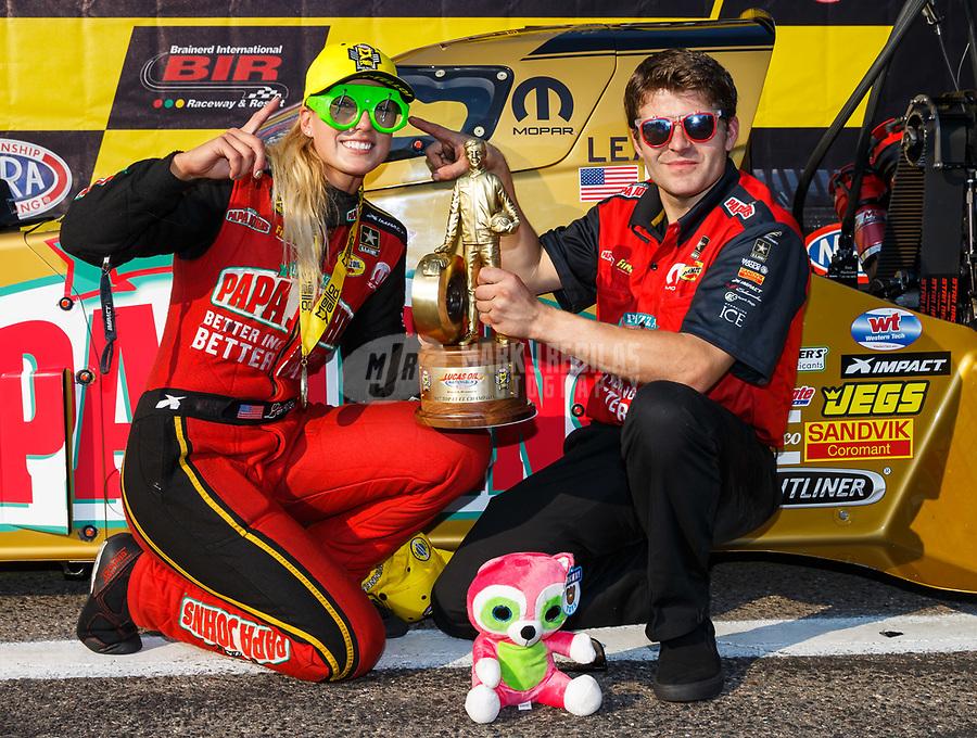 Aug 20, 2017; Brainerd, MN, USA; NHRA top fuel driver Leah Pritchett celebrates with crew after winning the Lucas Oil Nationals at Brainerd International Raceway. Mandatory Credit: Mark J. Rebilas-USA TODAY Sports