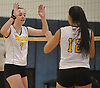 Wantagh No. 7 Carly Sullivan, left, and No. 12 Nicolette Laino react during a Nassau County varsity girls' volleyball match against South Side at Wantagh High School on Friday, October 23, 2015. Wantagh won 25-15, 25-17, 28-26.<br /> <br /> James Escher