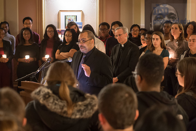 "January 16, 2017; First Year of Studies Dean Rev. Hugh Page speaks at a candlelight prayer service in the Main Building in observation of Martin Luther King Jr. Day. The event also marked the beginning of ""Walk the Walk"" week, a series of events an observances to celebrate and reflect on diversity and inclusiveness. (Photo by Matt Cashore/University of Notre Dame)"