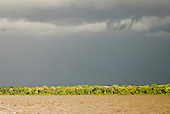 Pará State, Brazil. Threatening sky over the white water of the Amazon River.