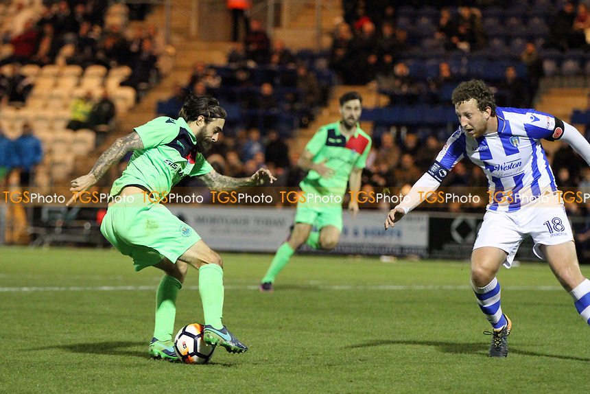 Rob Sinclair of Oxford City takes on Tom Eastman of Colchester United during Colchester United vs Oxford City, Emirates FA Cup Football at the Weston Homes Community Stadium on 4th November 2017