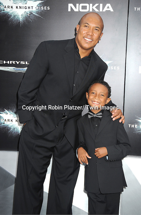 "Hines Ward and son Jadan attends the world premiere of ""The Dark Knight Rises"" on .July 16, 2012 at The AMC Lincoln Square Imax Theatre in New York City. The movie stars Christian Bale, Gary Oldman, Anne Hathaway, Tom Hardy, Marion Cotillard, Joseph Gordon-Levitt and Morgan Freeman."