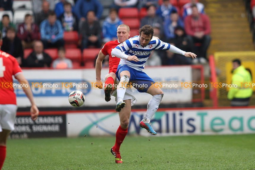 Michael Morrison of Charlton Athletic and Adam Le Fondre of Reading- Charlton Athletic vs Reading - Sky Bet Championship Football at the Valley, London - 05/04/14 - MANDATORY CREDIT: George Phillipou/TGSPHOTO - Self billing applies where appropriate - 0845 094 6026 - contact@tgsphoto.co.uk - NO UNPAID USE