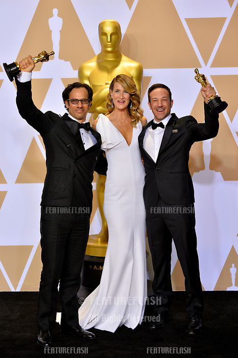 Laura Dern, Bryon Fogel &amp; Dan Cogan at the 90th Academy Awards Awards at the Dolby Theartre, Hollywood, USA 04 March 2018<br /> Picture: Paul Smith/Featureflash/SilverHub 0208 004 5359 sales@silverhubmedia.com