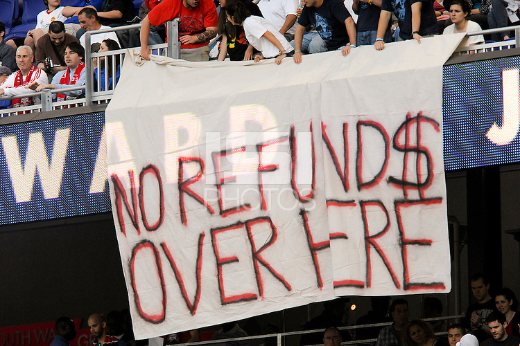 "New York Red Bulls fans hang a banner reading ""No refund$ over here"" at the start of the game. The Seattle Sounders defeated the New York Red Bulls 1-0 during a Major League Soccer (MLS) match at Red Bull Arena in Harrison, NJ, on May 15, 2010."