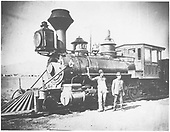 3/4 fireman's-side view of D&amp;RG #402 with 2 men posing.<br /> D&amp;RG  near Colorado Springs, CO
