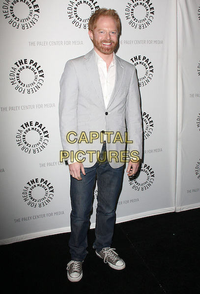 """JESSE TYLER FERGUSON .27th Annual PaleyFest Presents """"Modern Family"""" held At The Saban Theatre, Beverly Glen circle, USA, .26th February 2010..full length grey gray suit jeans trainers converse white shirt blazer jacket .CAP/ADM/KB.©Kevan Brooks/AdMedia/Capital Pictures."""