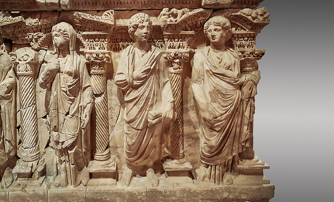 """Roman relief sculpted sarcophagus of Domitias Julianus and Domita Philiska, 2nd century AD, Perge. Antalya Archaeology Museum, Turkey.<br /> <br /> <br /> it is from the group of tombs classified as. """"Columned Sarcophagi of Asia Minor"""". <br /> The lid of the sarcophagus is sculpted into the form of a """"Kline"""" style Roman couch on which lie Julianus &  Philiska. This type of Sarcophagus is also known as a Sydemara Type of Tomb. Against a grey background."""