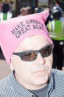 "A man wears a Pink Pussy hat with the slogan ""Make America Great Again"" before taking part in the Straight Pride Parade in Boston, Massachusetts, on Sat., August 31, 2019. The parade was organized in reaction to LGBTQ Pride month activities by an organization called Super Happy Fun America."