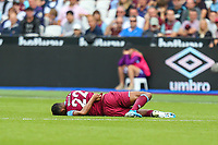 Sebastien Haller of West Ham United lays injured during the Premier League match between West Ham United and Manchester City at the London Stadium, London, England on 10 August 2019. Photo by David Horn.