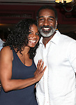 Audra McDonald & Norm Lewis.attending the celebration for Norm Lewis receiving a Caricature on Sardi's Hall of Fame in New York City on 5/30/2012