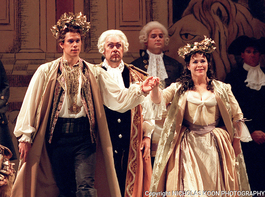 2000 - THE MAGIC FLUTE -  After passing the trials of water and fire and being admitted into the Temple of Wisdom, Tamino (David Miller), left, and Pamina (Pamela Armstrong), right, are married by Sarastro (Kevin Langan),center, in Opera Pacific's performance of The Magic Flute.