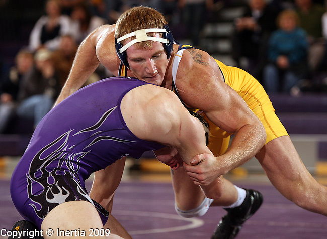 SIOUX FALLS, SD - DECEMBER 2:  Ty Copsey of Augustana controls Clint Whitley of the University of Sioux Falls in their 197 pound match Wednesday night at the Stewart Center. (Photo by Dave Eggen/Inertia)