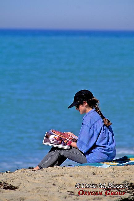 Bernie On Beach With Magazine