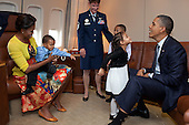 United States President Barack Obama and First Lady Michelle Obama greet the family of Senior Master Sergeant Roland Paramore (not pictured) aboard Air Force One prior to departure en route to New York, September 19, 2011. .Mandatory Credit: Pete Souza - White House via CNP