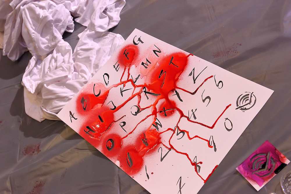 A stencil board with letters and numbers used to create signage.