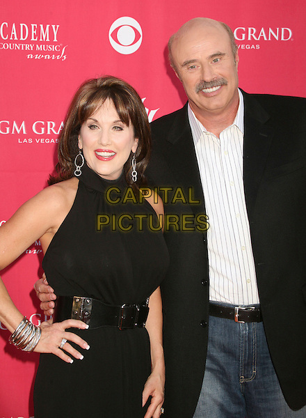 ROBIN McGRAW & DR. PHIL McGRAW.42nd Annual Academy Of Country Music Awards held at the MGM Grand Garden Arena, Las Vegas, Nevada, USA..May 15th, 2007.half length black hand on hip belt bracelets suit jacket .CAP/ADM/BP.©Byron Purvis/AdMedia/Capital Pictures