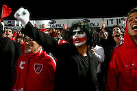 Hapoel Tel Aviv fans are seen during the Tel Aviv derby match against Macabi Tel Aviv in the Tel Aviv stadium, Blomfield. ..Hapoel Tel Aviv is seen as a left wing - Ashkenazi team, a club founded and supported by Jews of eastern European extraction and related to the Histadrut - the Israeli Workers Union. Hapoel Tel Aviv won the game 3 -1. Macabi Tel Aviv club is seen a bourgeois -middle - upper class. Photo by Quique Kierszenbaum  ..