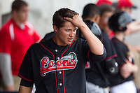 Great Lakes Loons shortstop Corey Seager #12 fixes his hair during a game against the Quad Cities River Bandits at Modern Woodmen Park on April 29, 2013 in Davenport, Iowa. (Brace Hemmelgarn/Four Seam Images)