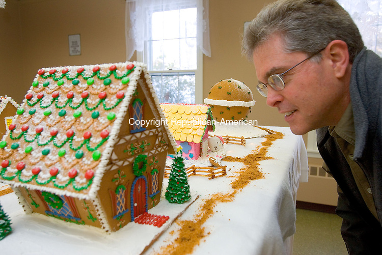 For Country Life Use Only<br /> MIDDLEBURY, CT. 06 December 2010-120610SV03--Ken Heidkamp of Middlebury checks out the gingerbread house his wife Lucy mad for the St. George's Church annual Gingerbread Village fundraiser in Middlebury Monday.<br /> Steven Valenti Republican-American