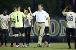 Wake Forest Demon Deacons head coach Bobby Muuss bumps fists with his team prior to the start of the match against the North Carolina State Wolfpack at W. Dennie Spry Soccer Stadium on September 7, 2018 in Winston-Salem, North Carolina.  The Demon Deacons defeated the Wolfpack 3-0 in double-overtime.  (Brian Westerholt/Sports On Film)