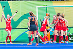 Lily Owsley #26 of Great Britain, Helen Richardson-Walsh #8 of Great Britain and Sophie Bray #19 of Great Britain celebrate during Netherlands vs Great Britain in the gold medal final at the Rio 2016 Olympics at the Olympic Hockey Centre in Rio de Janeiro, Brazil.