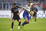 Krzysztof Piatek of AC Milan pulls on the shirt of Julian Chabot of Sampdoria during the Serie A match at Giuseppe Meazza, Milan. Picture date: 6th January 2020. Picture credit should read: Jonathan Moscrop/Sportimage