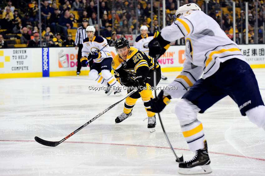 Saturday, December 31, 2016: Boston Bruins center Riley Nash (20) works to stop a shot during the National Hockey League game between the Buffalo Sabres and the Boston Bruins held at TD Garden, in Boston, Mass. Boston defeats Buffalo 3-1.  Eric Canha/CSM