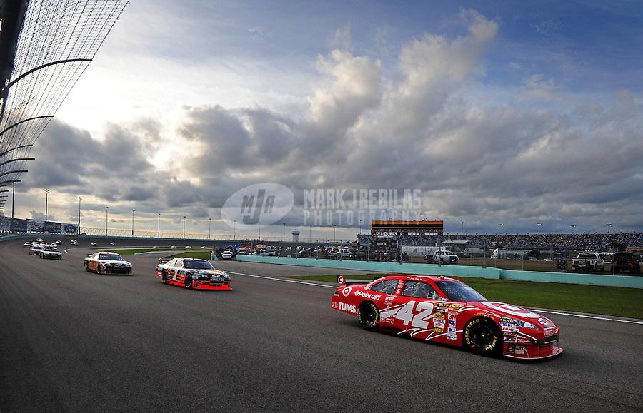 Nov. 22, 2009; Homestead, FL, USA; NASCAR Sprint Cup Series driver Juan Pablo Montoya (42) leads Martin Truex Jr (1) during the Ford 400 at Homestead Miami Speedway. Mandatory Credit: Mark J. Rebilas-