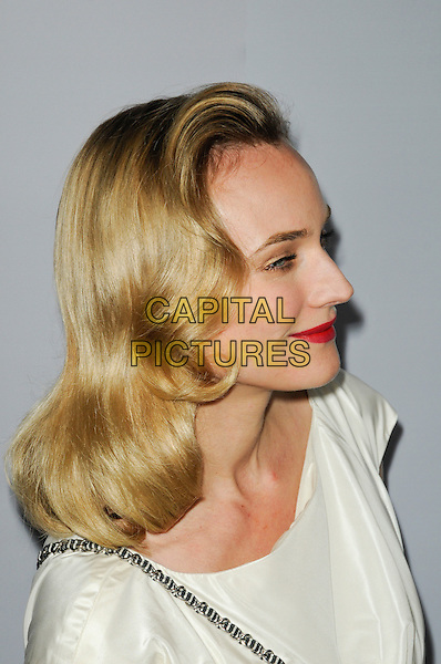 "DIANE KRUGER .Arriving at the Blu-Ray and DVD Release Celebration for ""Inglourious Basterds"" at the New Beverly Cinema in Los Angeles, California, USA, .New Beverly Cinema, Los Angeles, California, USA, December 14th, 2009..portrait headshot red lipstick make-up white cream shiny wavy hair profile .CAP/ROT.©Lee Roth/Capital Pictures"