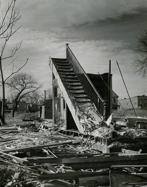 "1953  December  05..Redevelopment         Atlantic City (R-1)..""Stairway to the Stars"".Olney Road W of Cooke Street - 3rd house in - 100 block.Atlantic City Demolition..Volmer - Ledger-Dispatch.NEG# 187.."