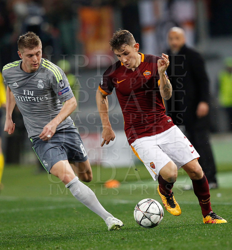 Calcio, andata degli ottavi di finale di Champions League: Roma vs Real Madrid. Roma, stadio Olimpico, 17 febbraio 2016.<br /> Roma's Lucas Digne, right, is challenged by Real Madrid's Toni Kroos during the first leg round of 16 Champions League football match between Roma and Real Madrid, at Rome's Olympic stadium, 17 February 2016.<br /> UPDATE IMAGES PRESS/Riccardo De Luca