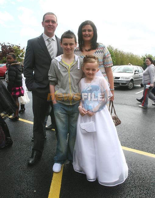 Moya, David, Ben and Melissa McLernon at Marymount First Holy Communion in Ballsgrove Church...Photo NEWSFILE/Jenny Matthews.(Photo credit should read Jenny Matthews/NEWSFILE)....This Picture has been sent you under the condtions enclosed by:.Newsfile Ltd..The Studio,.Millmount Abbey,.Drogheda,.Co Meath..Ireland..Tel: +353(0)41-9871240.Fax: +353(0)41-9871260.GSM: +353(0)86-2500958.email: pictures@newsfile.ie.www.newsfile.ie.FTP: 193.120.102.198.