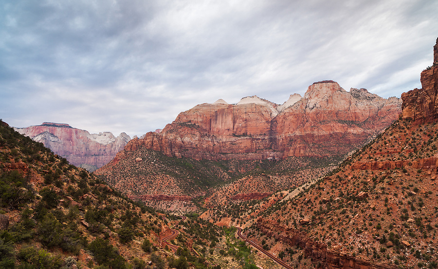 The road curves through the colorful rock strata of Zion National Park, Utah.