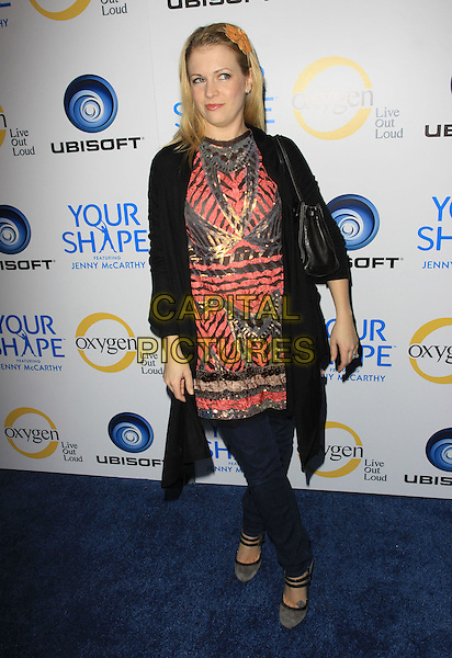"MELISSA JOAN HART.Oxygen TV and Ubisoft Celebrate ""Your Shape"" featuring Jenny McCarthy held Hyde Lounge, West Hollywood, California, USA..December 2nd, 2009.full length jeans denim black jacket long pink pattern top.CAP/ADM/KB.©Kevan Brooks/AdMedia/Capital Pictures."